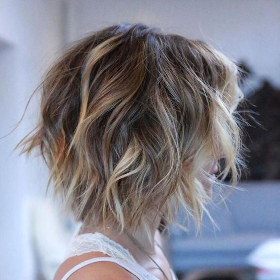 trendy curly short hairstyle looks for free spirits 11