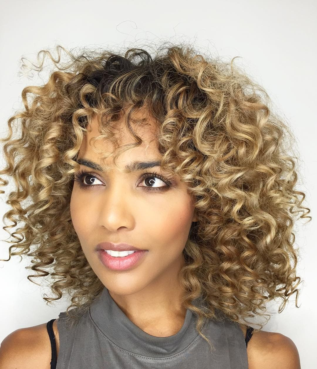 trendy curly short hairstyle looks for free spirits 31